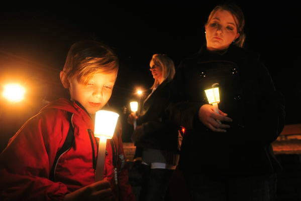 Cade Smith, 6, and his mother, Brandi, join a vigil in Midland City, Ala., where a hostage standoff has stretched over four days.