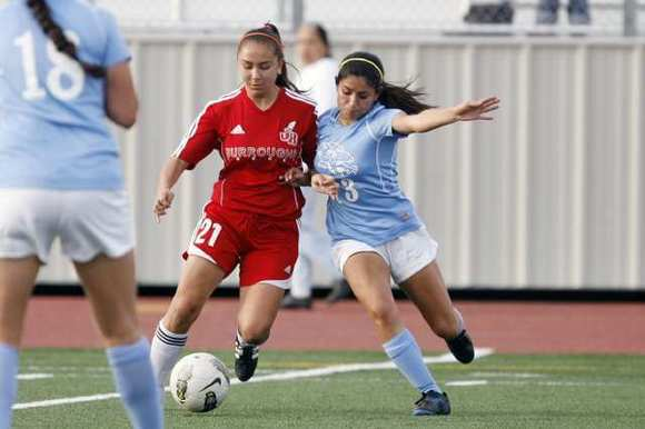 Burroughs' Noelle Garcia, left, and CV's Karina Costila fight for the ball  during Friday's game.
