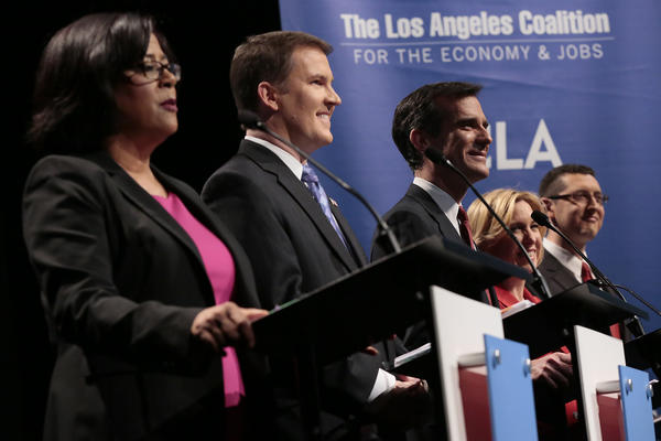 Los Angeles Mayoral candidates, left to right, Jan Perry, Kevin James, Eric Garcetti, Wendy Greuel and Emanuel Pleitez are seen before a debate sponsored by the Los Angeles Coalition for the Economy and Jobs at UCLA's Royce Hall.