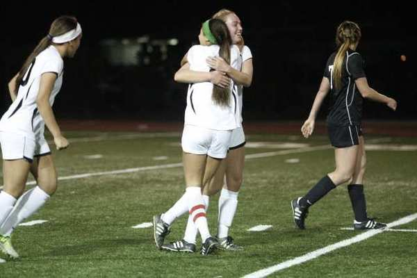 FSHA's Hailey James, top center, embraces Savannah Viola after scoring in a 3-2 Mission League win over Harvard Westlake.