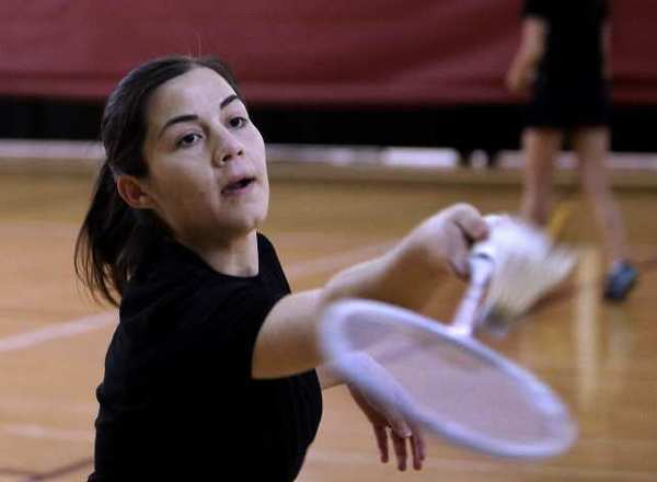 Pasadena City College sophomore Angelica Ortiz, 19, the 2012 Women's Badminton State Champion, is seen practicing at the school's gym on Tuesday. (Raul Roa/Staff Photographer)