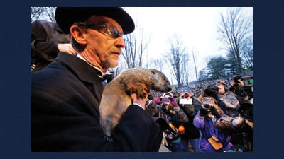 In this Feb. 2, 2012 file photo, Groundhog Club handler Ron Ploucha holds Punxsutawney Phil, the weather prognosticating groundhog, during the 126th celebration of Groundhog Day on Gobbler's Knob in Punxsutawney, Pa.