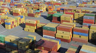 Longshoremen and the management of East Coast and Gulf ports reached a tentative agreement on a new master contract late Friday night, averting a threatened walkout next week.