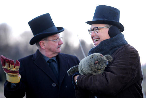 Carson Frey of Germansville, left, and Bob Schantz of Greenawalds, holding Lee the groundhog, grandson of Yahdee the groundhog, await word on Yahdee's prediction of the forthcoming weather at the Groundhog Day event at sunrise. This was at the annual Grundsau Lodsch Number 16 of Schnecksville Goundhog Day event held at Wehr's Dam Covered Bridge Park at sunrise Saturday. In the opinion of Yahdee the lodge's groundhog there will be some cold days and there will be some warm days ahead which means people can start their gardens and plant their peas on St. Patrick's Day in March.