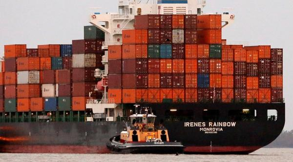 The Monrovian container ship Irenes Rainbow arrives at the Port of New Orleans just before sunrise in New Orleans. The union for longshoremen along the East Coast and Gulf of Mexico has agreed to a tentative deal on a labor contract after several months of negotiations.