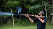 WASHINGTON — Facing questions about President Obama's experience with firearms, the White House has released a photo of the chief executive in the act of firing one.