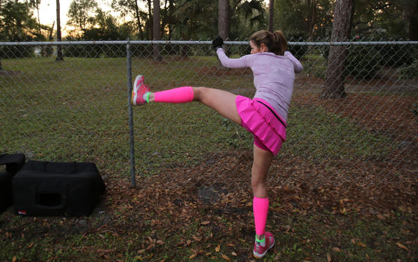 Mylene Dally stretches before the start of the Lady Track Shack 5k in Winter Park, Fla.