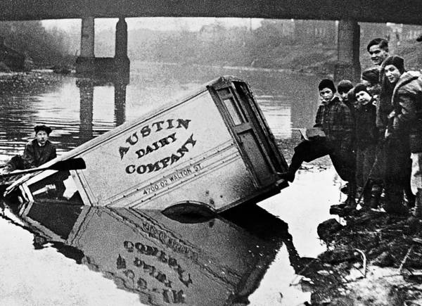 A dairy truck loaded with milk ended up in a river during the Milk War.