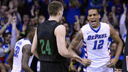 As everything else did in overtime Saturday, the ball came Eric Atkins' way. To the misfortune of his eye socket, so did the flailing fingers of DePaul's Worrel Clahar. One inadvertent gouge from Clahar had Notre Dame's point guard grimacing and squinting his way to the free throw line, the day officially leaving a digital imprint.
