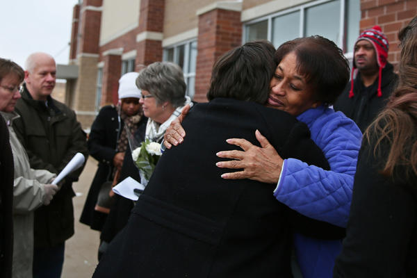 Barbara Hamilton, facing, hugs Michele Talos during a small gathering of family members marking the 5-year anniversary of the deaths of five women who were killed at a Lane Bryant store in Tinley Park. Hamilton's daughter Rhoda McFarland and Talos' sister Jennifer Bishop were killed in the 2008 robbery.