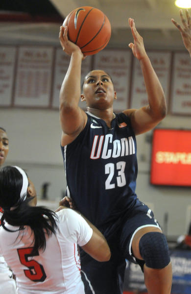 UConn's Kaleena Mosqueda-Lewis shoots over St. John's guard Nadirah McKenish at Carnesecca Arena Saturday afternoon. Mosqueda-Lewis led the Huskies with 19 points and 10 rebounds.