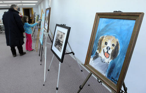 Guests look over the Community Art Show during day two of the Emmaus Arts Commission SnowBlast Winter Festival Saturday.