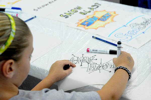 Abby Barnes 10, of Macungie works on her SnowBlast Graffiti Art during day two of the Emmaus Arts Commission SnowBlast Winter Festival Saturday.