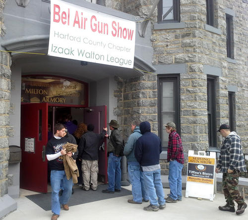 Visitors waited to get into the Bel Air Gun Show at the Bel Air Reckord Armory Saturday afternoon. The three-day show is setting attendance records, according to organizers.