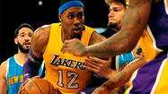 AUBURN HILLS, Mich. -- Lakers center Dwight Howard is expected to play Sunday against Detroit after making a quick trip to Los Angeles for a minor shoulder procedure.