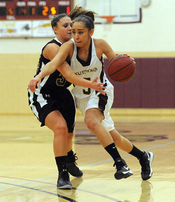 Bloomsburg's Dana Wieller (left) guards Kutztown's Natalya Lee (right) during their college women's basketball game.