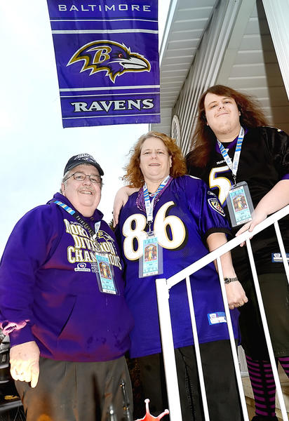 The Bickle family of Boonsboro will be going to the Super Bowl to see their Ravens play the 49ers. Left to right are Tom Bikle, his wife Lisha Bikle, and their son Josh Bikle.
