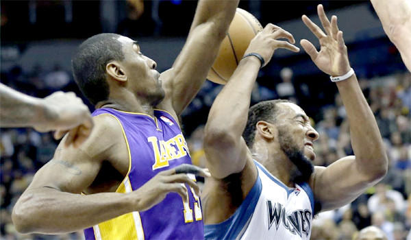 Metta World Peace goes for the ball against the Minnesota Timberwolves.