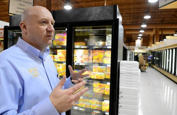 Wegmans store manager Mike Kier explains changes to the store's revamped frozen foods isle.