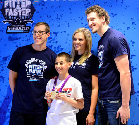 "Isaiah Moreef, 10, of South Whitehall, a member of Parkland Aquatics Club, poses with Olympic swimmers Tyler McGill, left; Chloe Sutton, center, and Adam Brown of the United Kingdom, right.  Parkland Aquatic Club hosted a ""Fitter and Faster"" clinic and seminar for swimmers at Parkland High School Saturday. The event included Olympians Tyler McGill and Chloe Sutton from the USA and Adam Brown from the United Kingdom."