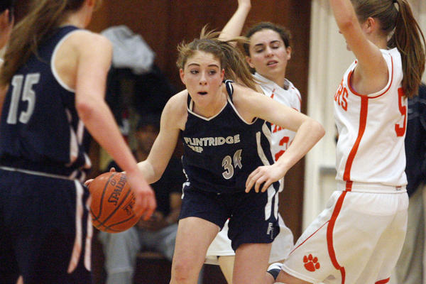 Flintridge Prep's Tala Ismail drives to the basket during a game against Pasadena Poly at Pasadena Poly on Saturday, February 2, 2013.