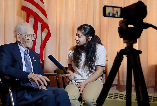 WWII veteran William Beckner, is interviewed by Heidi Abdou-Ghadi at Morris Frock American Legion on Saturday.  The organization Friends of the National World War II Memorial interviewed and filmed area veterans.