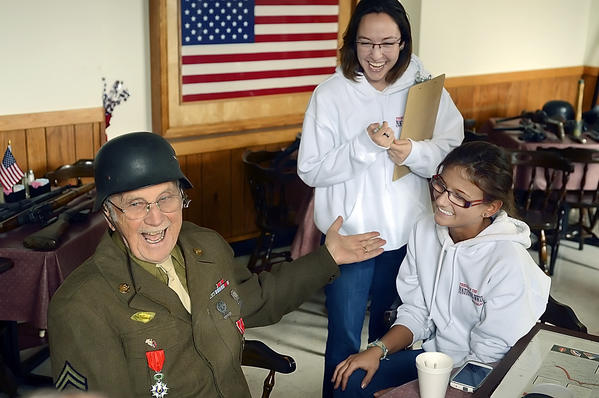 WWII veteran Jack Myers of Hagerstown has a laugh with Nathalie Wisecup and Brianna Beadenkopff. Myers was interviewed about his experience in the war. Friends of the World War II Memorial interviewed and filmed area veterans at Morris Frock American Legion on Saturday.