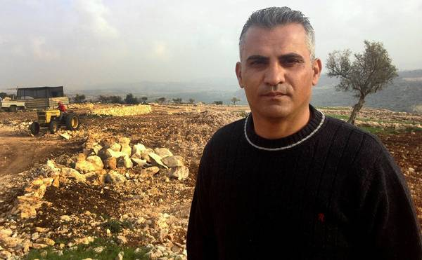 "West Bank farmer turned filmmaker Emad Burnat, 41, near the village of Bilin in the West Bank. His movie ""5 Broken Cameras"" is nominated for an Oscar in the documentaries category."