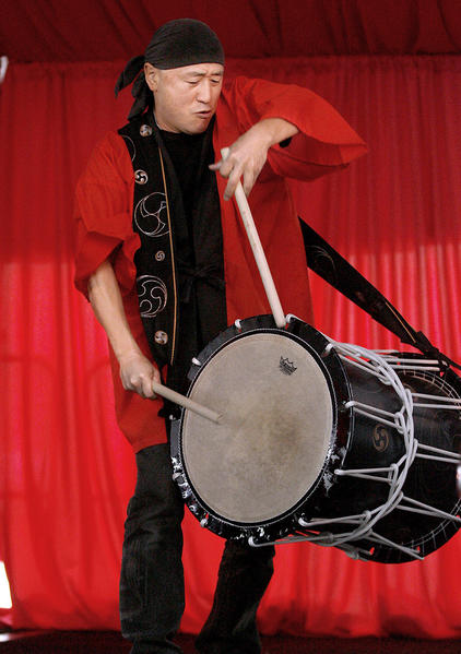 Taiko Center of L.A. special guest drummer Hiroyuki Hayashida plays tfor the crowds during the Third Annual Lunar New Year Festival at the Pacific Asia Museum in Pasadena on Saturday, February 2, 2013.