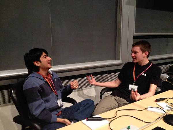 Kalki Seksaria (left) and Owen Gray of Thomas Jefferson High School for Science and Technology in Alexandria discuss an earlier question during a break in the final round of the Virginia Regional High School Science Bowl at Jefferson Lab on Satruday. Their team won the regional contest.