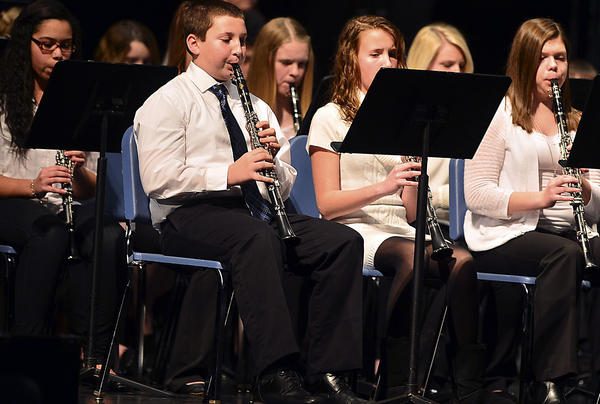 Students play in the All-County Middle School Concert Band under the direction of guest conductor Dr. David Zerull Saturday at North Hagerstown High School.