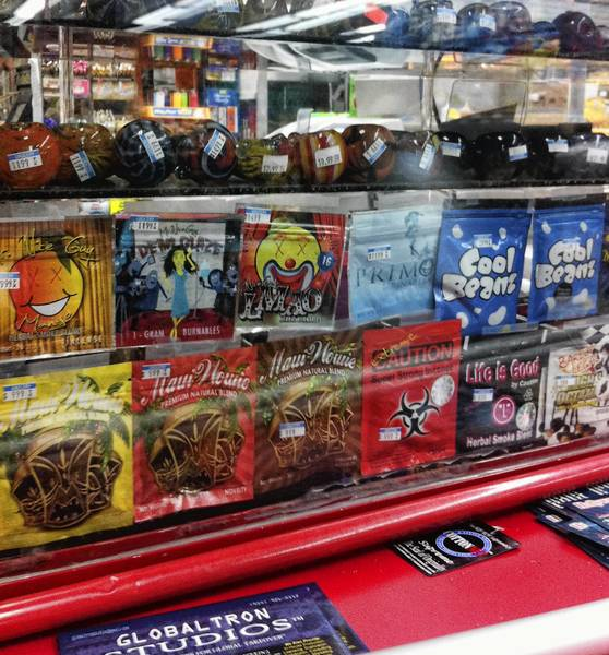 Synthetic marijuana, sold in colorful packages, sits behind the glass counter at a Kwik Stop in Hollywood.