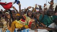 Malians cheer  France's President Hollande