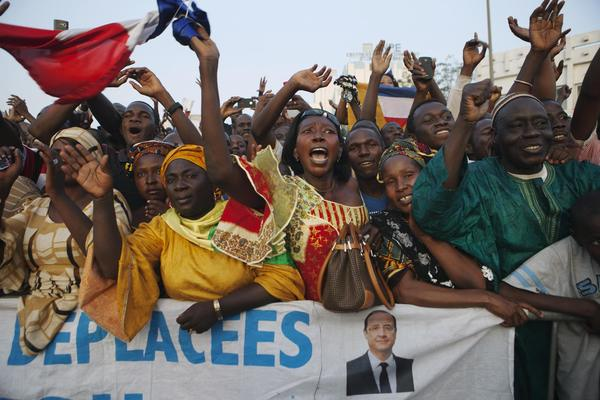 Malians cheer as France's President Francois Hollande (not pictured) speaks at Independence Plaza in Bamako, Mali.