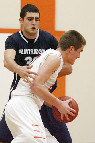 Flintridge Prep's Kareem Ismail, defends Pasadena Poly's Wil Genske during a game at Pasadena Poly on Saturday, February 2, 2013.