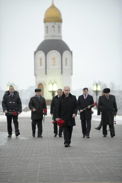 Russia's President Putin takes part in a wreath laying ceremony as he visits the Mamayev Kurgan World War Two memorial complex in the city of Volgograd.