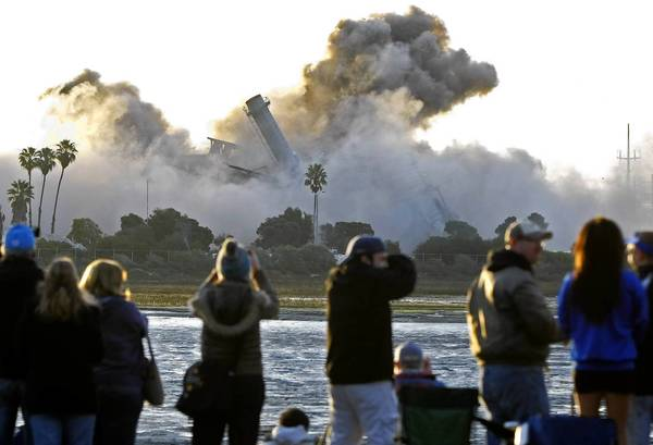 More than 7,000 people turned out to watch the controlled implosion of the South Bay Power Plant in Chula Vista, Calif. The debris will be removed and the land cleaned up for a possible future park and resort hotel.