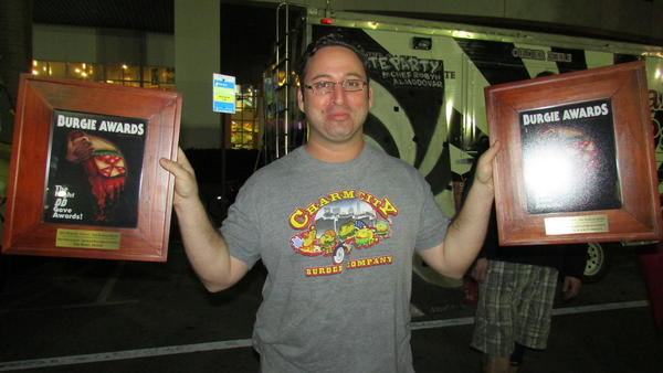 Mike Saperstein holds his Burgies for best restaurant in Broward-Palm Beach (the Rebel House) and best burger in Broward-Palm Beach (Charm City Burger Company).