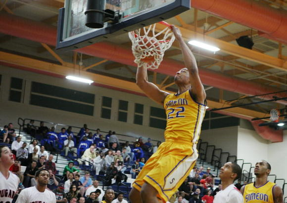 Simeon's Jabari Parker dunks during the first half of a Penny Hardaway's Las Vegas Hoopfest tournament at Coronado High School on Saturday.