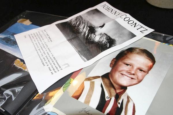 "A photo book made by one of Jonathan ""Johnny"" Coontz's sisters is on display at the home of Gary Robertson, a childhood friend of Coontz who grew up four doors down."