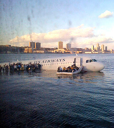 In this photo taken by a passenger on a ferry, airline passengers escape the US Airways plane into the frigid waters of the Hudson River. All 155 people aboard were evacuated.