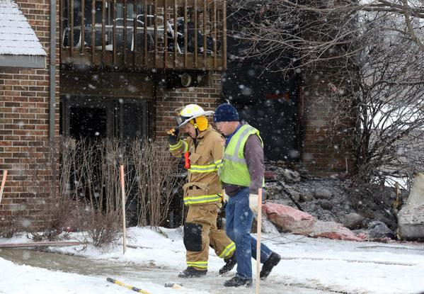 Firefighters from Huntley and surrounding areas work at the scene of a fatal fire at the 11700 block of Woodcreek Road in Huntley on Sunday morning. An adult male died in the fire which broke out around 6:15 Sunday morning, while another approximately ten people have been displaced.