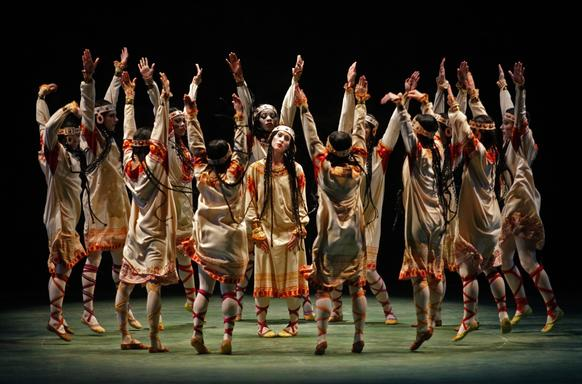 "Elizabeth Hansen, playing the Chosen One, center, is surrounded by the Young Maidens as members of the Joffrey Ballet perform ""The Rite of Spring"" at the Dorothy Chandler Pavilion in Los Angeles."