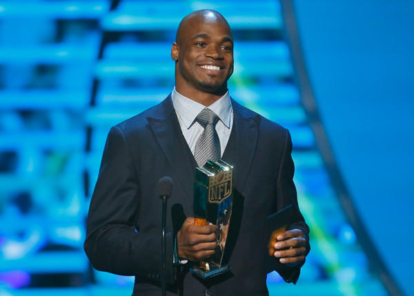Minnesota Vikings running back Adrian Peterson accepts the NFL MVP award during the NFL Honors awards show in New Orleans, La. on Feb. 2.