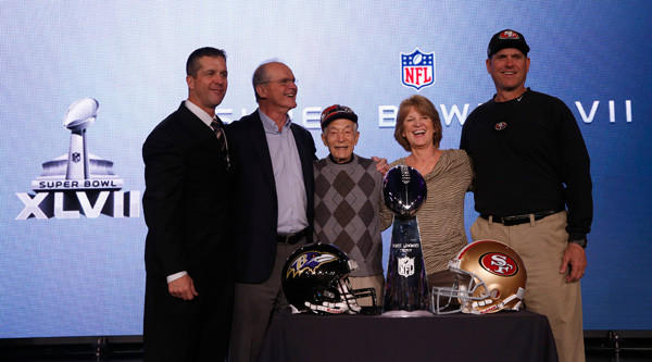 San Francisco 49ers head coach Jim Harbaugh, far right, and his brother, Baltimore Ravens head coach John Harbaugh, far left, pose with family members during a joint press conference ahead of the NFL's Super Bowl XLVII in New Orleans.