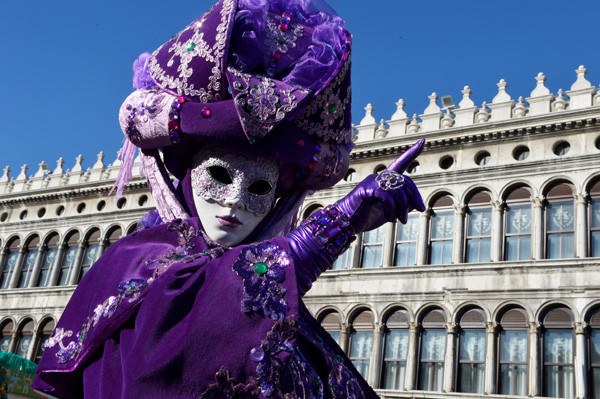 A costumed reveler poses at St Mark's square during carnival on Feb. 3 in Venice. The 2013 edition of the Venice carnival is untitled ' Live in Color' and runs from Jan. 26 to Feb.12.