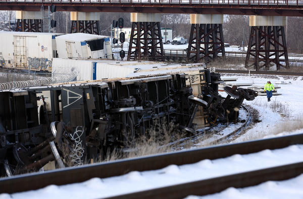 A worker on the scene of a Union Pacific train derailment in Bellwood, Ill., near the intersection of Erie Street and Eastern Avenue on Sunday. Several of the cars were said to have been leaking diesel fuel.