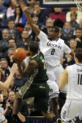 Deandre Daniels and UConn had a hard time stopping Victor Rudd and USF at Gampel Pavillion Sunday afternoon during the first half in Storrs as the Bulls held a 27-15 lead at the half.