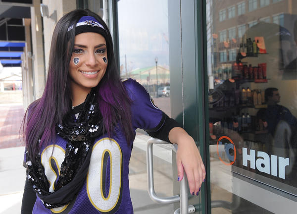 Alizabeth Weisberg, who grew up in Pikesville and now lives in Miami, FL, gets her hair colored purple at the Hair Cuttery on McHenry Row. She flew into Baltimore to watch the Super Bowl.