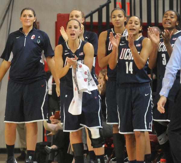 Stefanie Dolson, far left, could only watch as UConn held off St. John's Saturday afternoon in New York. She sat out because of illness.